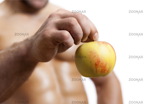 an apple holding by a male hand
