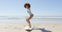 Cheerful woman on a surfboard