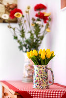 Flowers on a table. Yellow tulips and spring flowers