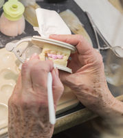 Dental Technician Applying Porcelain To 3D Printed Implant Mold