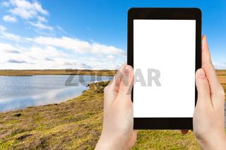 tourist photographs Leirvogsvatn lake in Iceland