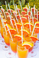 orange juice mixed in a glasses