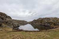 Beautiful landscape with a calm bay in the Rovaer island in Rovaer archipelago in Haugesund, Norway.