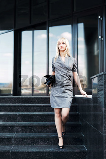 Young fashion business woman on the steps