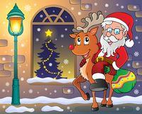 Santa Claus on reindeer in town