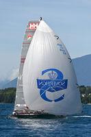 Sailing boat flying a spinnaker sail on Lake Geneva, Bol d'Or Mirabaud regatta, Geneva, Switzerland