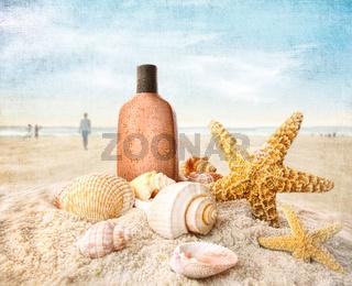 Suntan lotion and seashells on the beach