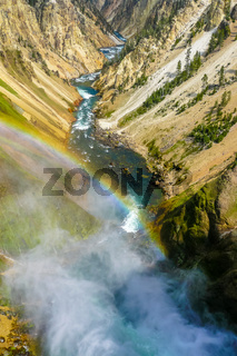 Yellowstone waterfall with rainbow at inspiration point