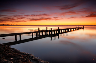 Beautiful skies over Tuggerah Lake with old jetty