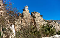 Bell tower on a rock of Guadalest. Spain