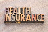 health insurance word abstract in wood type