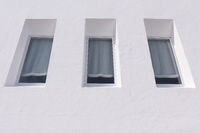 View on three windows of a white house