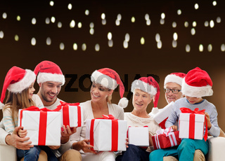 happy family in santa hats with christmas gifts
