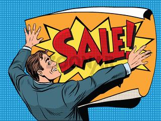 Retro man unfolds a poster sale