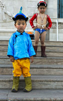 Two boys posing as traditional Nadaam wrestlers, Naadam festival, Ulaanbaatar, Mongolia