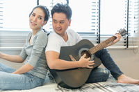 Young Couples playing guitar