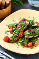 Pork ribs with a spicy garlic and fresh herbs sauce