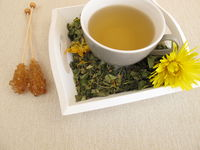 Herbal tea with marigold and cornflower on tray