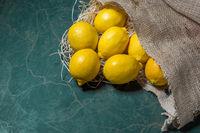 Lemons spilling from a burlap sack