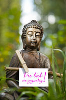 Buddha statue with the words you are unique!