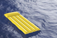 Pool raft floating on water