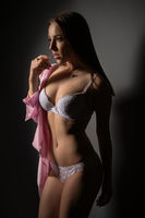 Photo of charming brown-eyed woman in lingerie