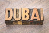 Dubai word abstract in wood type