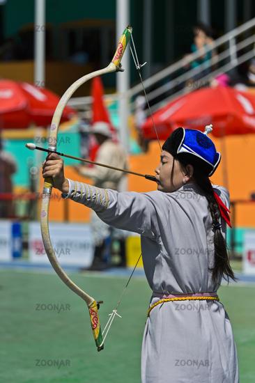 Female archer in traditional deel costume, Ulaanbaatar, Mongolia