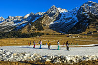 Kids practicising on improvised cross-country skiing runs made of artificial snow, France