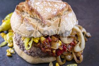 Hamburger with Chili Relish on old Metal Sheet