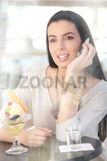 Happy woman sitting in cafe