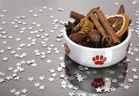 Cat Bowl with Christmas decoration. Cinnamon, nuts, orange peel