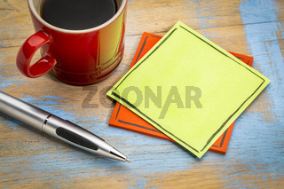 blank green sticky note with coffee