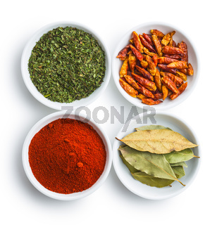 Various dried herbs and spices in bowl.