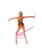 Pretty slim gymnast in nice sportssuit in studio