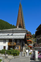 In the village centre of Sass-Fee during summer, spire of the parish church, Saas-Fee, Valais
