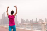 young woman celebrating a successful training run