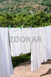 drying linen on open backyard in Sicily