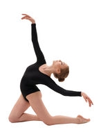 Young slim gymnast in gracefull pose studio shot