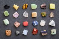 colorful gemstones on slate stone