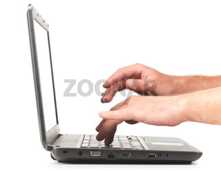hands are working on laptop