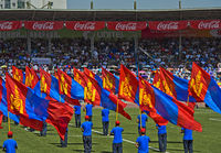 Standard bearers with the Mongolian national flag, National Sports Stadium, Ulaanbaatar, Mongolia