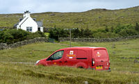 Royal Mail service car on teh way to a remote house, Sutherland, Scotland, Great Britain