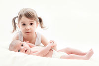 elder sister with the newborn child
