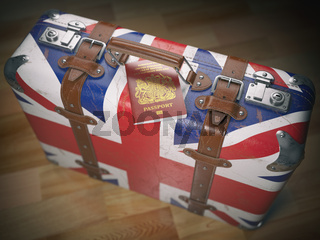 Travel or immigration concept. Passport of UK and suitcase with flag of United Kingdom