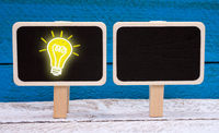 Idea and Innovation - chalkboard with light bulb and copy space