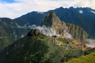 Inca citadel Machu Picchu with morning fog, Peru