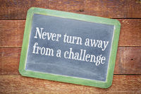 Never turn away from a challenge blackboard sign