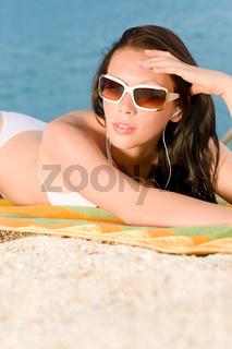 Young sexy bikini model relaxing with music
