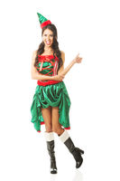 Full length woman wearing elf clothes showing thumbs up